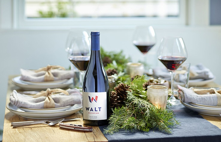 Visit WALT Napa Oxbow festive image with WALT Pinot Noir wine and tablewear in the background
