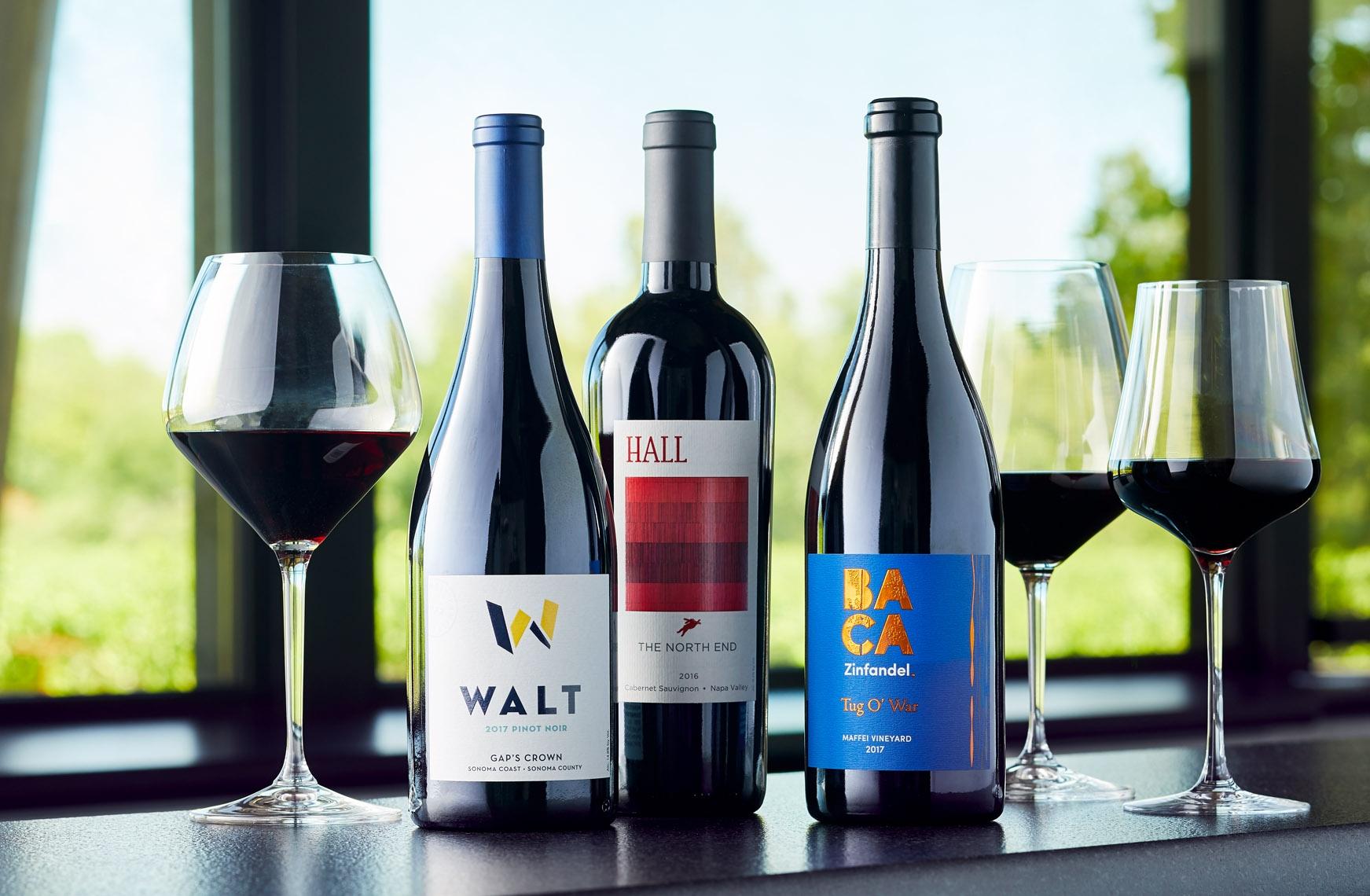 HALL cabernet sauvignon, WALT pinot noir and BACA zinfandel bottles on bar in Healdsburg tasting room