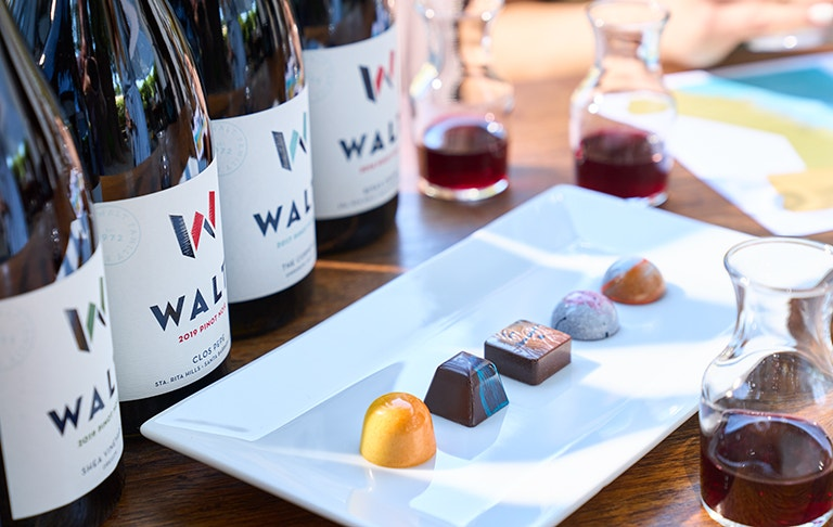WALT Wine & Chocolate Tasting image with Pinot Noir bottles and chocolates shown
